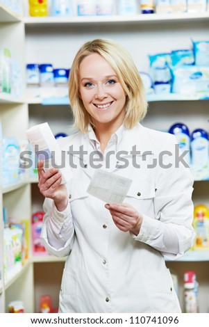 Cheerful happy pharmacist chemist woman working in pharmacy drugstore with doctor prescription