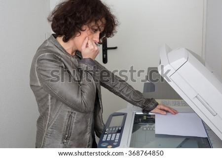 Cheerful happy woman man using a copy machine isolated - stock photo