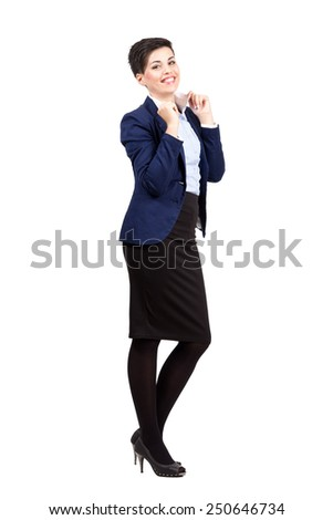 Cheerful happy young business woman posing while holding collar.  Full body length portrait isolated over white background. - stock photo