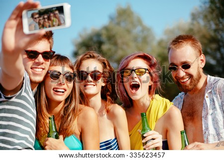 Cheerful Hipster Friends At The Beach Taking Selfie Using Smart Phone