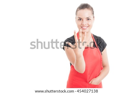 Cheerful hypermarket employee rising five fingers and smiling isolated on white background with text area - stock photo