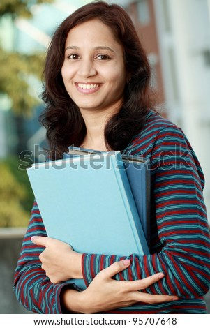 Cheerful indian female college student - stock photo