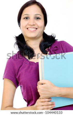 Cheerful Indian female student against white