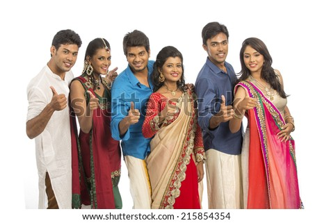 Cheerful Indian young different culture family on white background. - stock photo