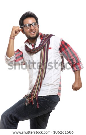 Cheerful indian young man posing to the camera.