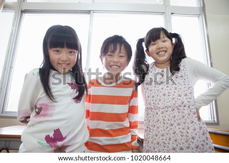 Cheerful japanese elementary school student