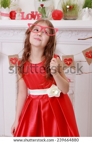Cheerful joyful little girl laughing and hamming in a beautiful dress - stock photo
