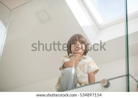 Cheerful kid at his room in new house