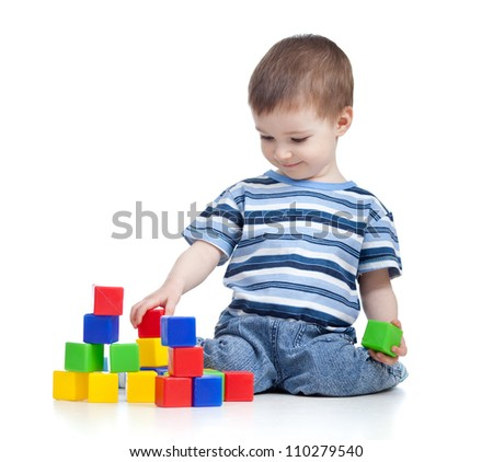 cheerful kid boy with construction set over white background - stock photo