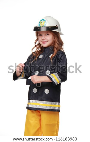 Cheerful kid in firefighter costume/little girl in fireman costume