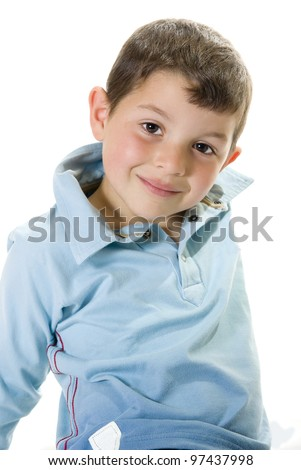 Cheerful kid looking directly to you