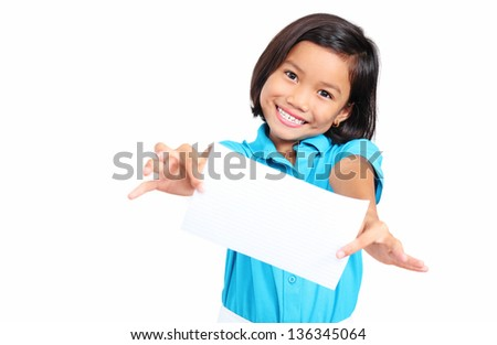 Cheerful kid showing a blank white paper. Isolated in white background. - stock photo