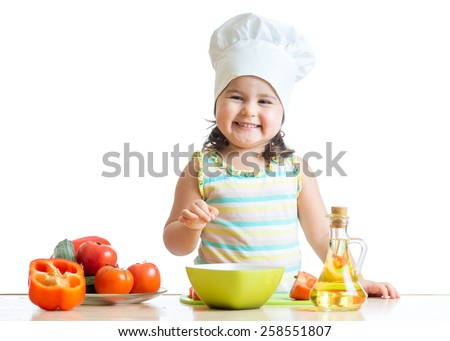 cheerful kid toddler preparing healthy food in the kitchen