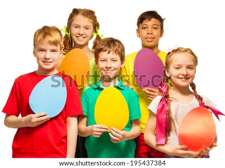 Cheerful kids holding egg shape colourful cards