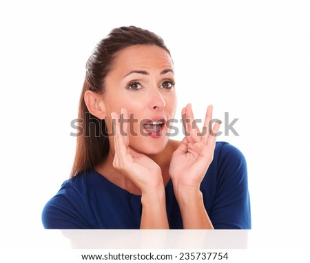 Cheerful lady in blue shirt gesturing screaming in white background - copyspace - stock photo