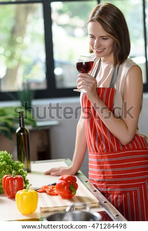 Cheerful lady resting while preparing food