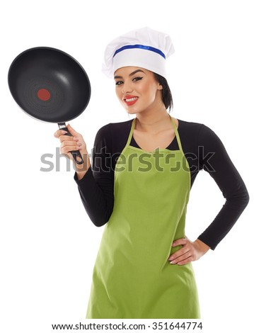 Cheerful latino woman cook with frying pan isolated on white - stock photo