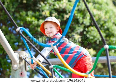cheerful little boy at the playground - stock photo
