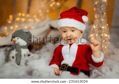 cheerful little boy dressed as Santa Claus - stock photo