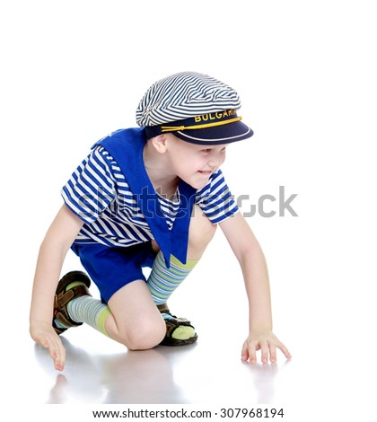 Cheerful little boy in a sailor suit-Isolated on white background - stock photo