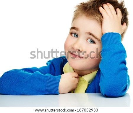 Cheerful little boy in blue cardigan and yellow shirt  - stock photo