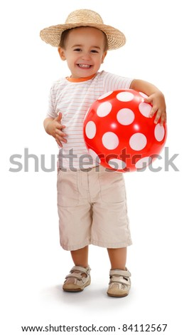 Cheerful little boy in straw hat, holding big red dotted ball - stock photo