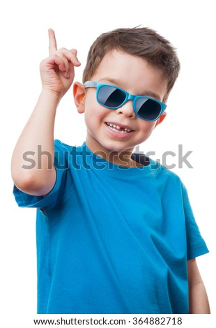 Cheerful little boy in sunglasses showing thumbs up gesture, isolated on white background - stock photo