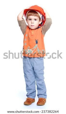 Cheerful little boy in the construction helmet.Isolated on white background portrait. - stock photo