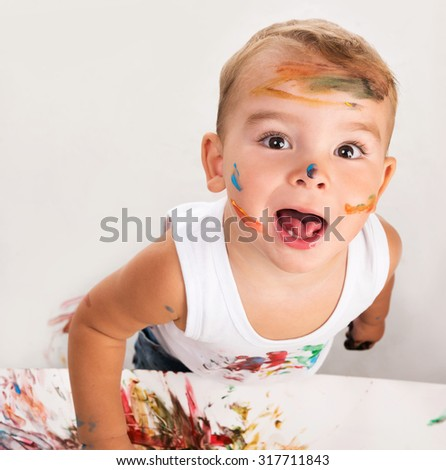 cheerful little boy with painted face portrait