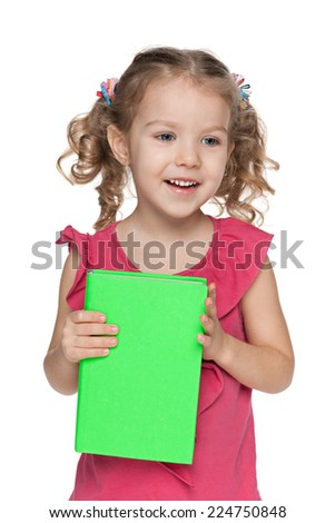 Cheerful little girl closes her mouth with her hands - stock photo