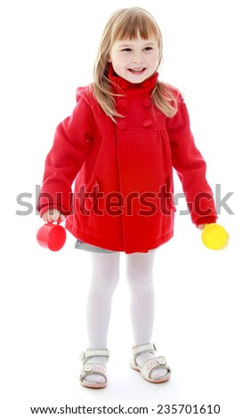 Cheerful little girl enjoys his toys. Happy childhood, fashion, autumnal mood concept. Isolated on white background - stock photo