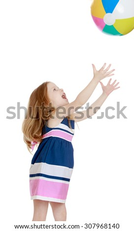 Cheerful little girl in a striped summer dress stretched out his hands to hands to catch the ball-Isolated on white background - stock photo
