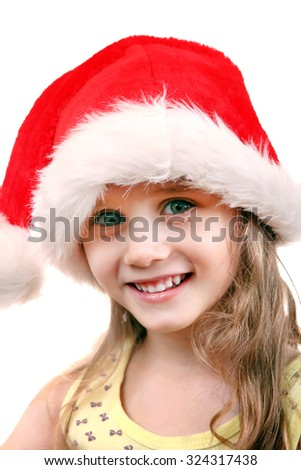 Cheerful Little Girl in Santa's Hat on the White Background - stock photo
