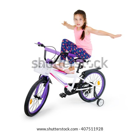 cheerful little girl on a sports bike on a white background - stock photo