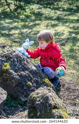 cheerful little girl playing - stock photo