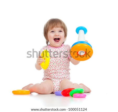 cheerful little girl playing with colorful toy isolated on white - stock photo