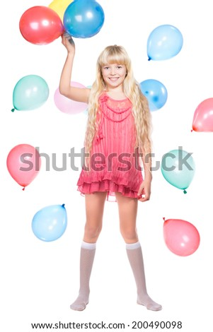 Cheerful little girl posing with balloons. Isolated on white - stock photo