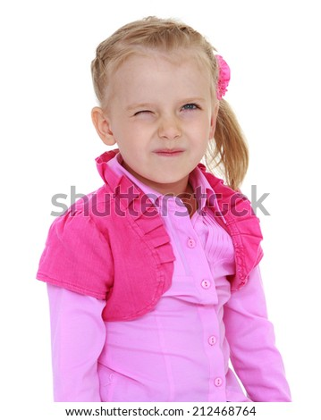cheerful little girl winking eye on white background.The concept of child development, education, recreation - stock photo