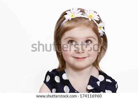 Cheerful little girl with flower headband - stock photo