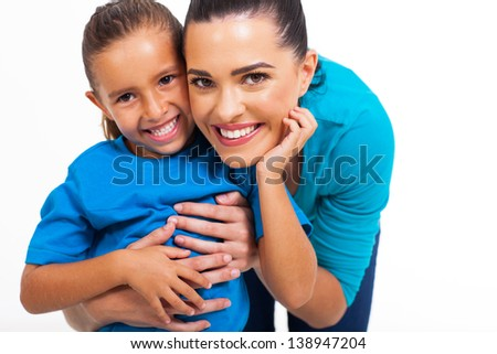 cheerful little girl with her loving mother on white background - stock photo
