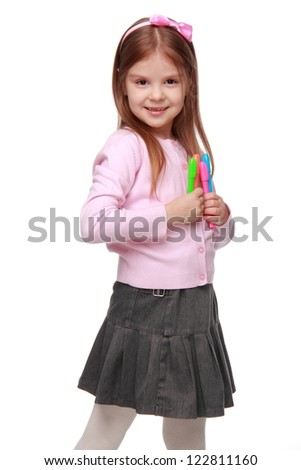 Cheerful little girl with lots of colorful felt-tip pens isolated on white background/Charming young girl on Education theme