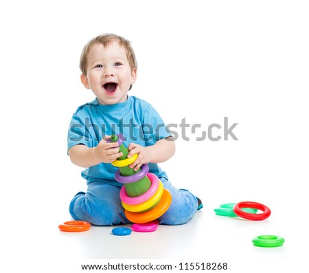 cheerful little kid boy playing with colorful toy isolated on white - stock photo