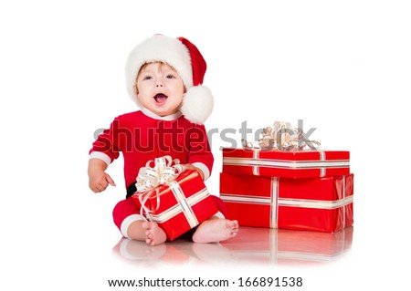 Cheerful little Santa Claus with presents. Isolated on white background.