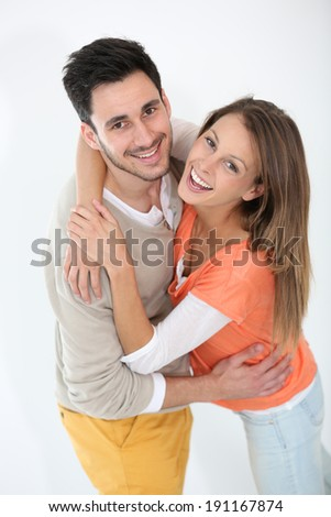 Cheerful lovely couple smiling at camera - stock photo