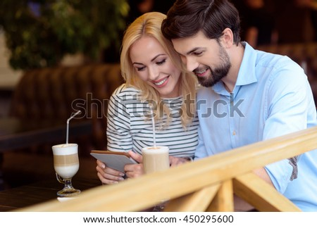 Cheerful loving couple having rest in cafeteria - stock photo