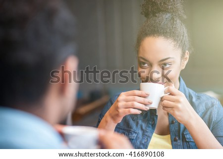 Cheerful loving couple is talking in cafel