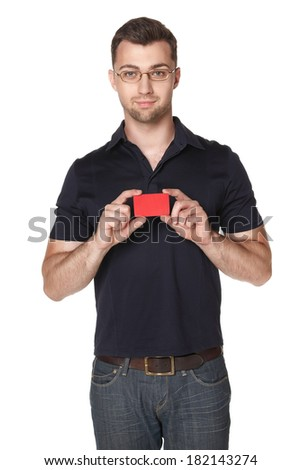 Cheerful male in eyeglasses showing red card in hand, over white background - stock photo