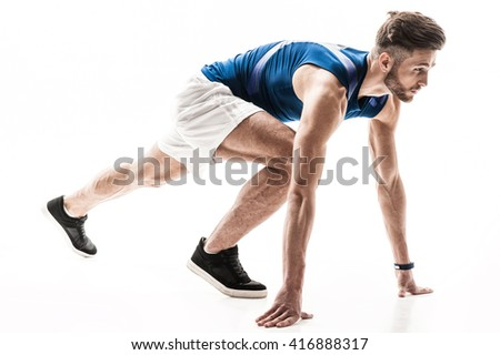 Cheerful male jogger is ready to run