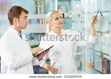 cheerful male pharmacist chemist man portrait in pharmacy drugstore - stock photo