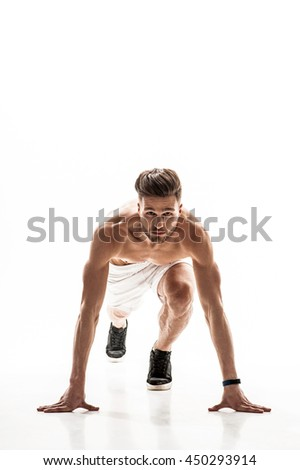 Cheerful male runner preparing to jog - stock photo